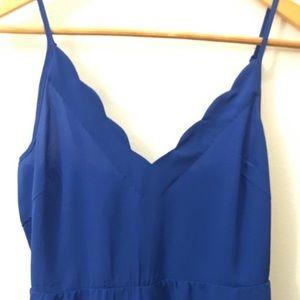 Lush blue scalloped romper. Size M